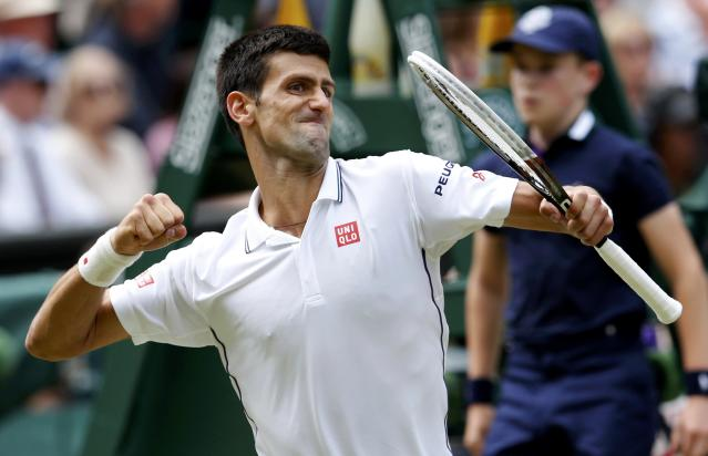 Novak Djokovic of Serbia reacts to winning the second set during his men's singles final tennis match against Roger Federer of Switzerland at the Wimbledon Tennis Championships, in London July 6, 2014. REUTERS/Suzanne Plunkett (BRITAIN - Tags: SPORT TENNIS TPX IMAGES OF THE DAY)