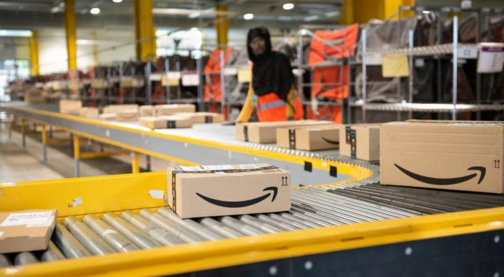 Logistics activity on the Amazon site of Vélizy-Villacoublay in France. Packages are sorted by workers on coneyors.