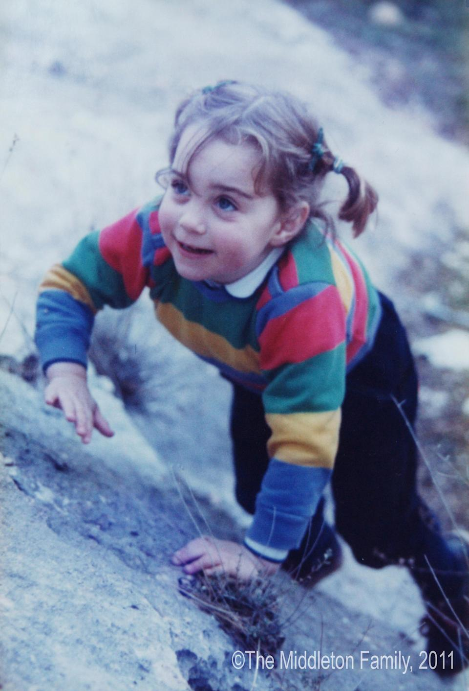 She showed an early love for exploring and activity - here aged three-and-a-half on holiday in the Lake District. We love those pigtails that mean she is ready for action. (The Middleton Family)