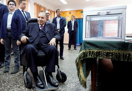 FILE PHOTO: Algeria's President Abdelaziz Bouteflika looks at journalists after casting his ballot during the parliamentary election in Algiers, Algeria, May 4, 2017. REUTERS/Zohra Bensemra/File Photo