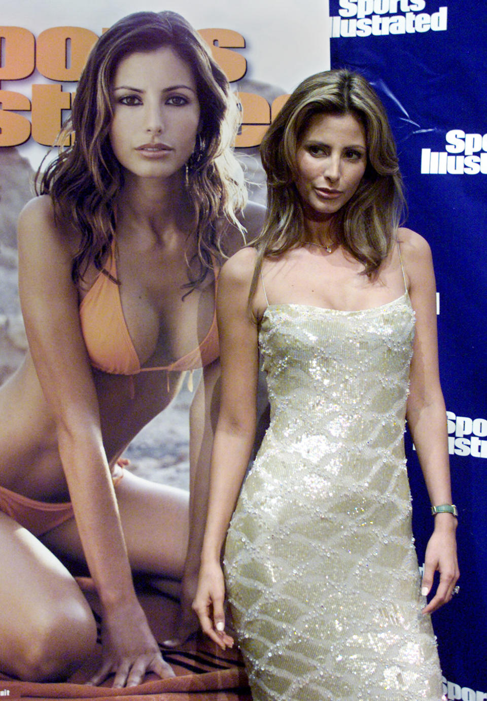 Model Elsa Benitez poses next to an enlarged version of the cover of the 2001 Sports Illustrated swimsuit issue featuring her photo during a photo opportunity in New York on February 20, 2001. Benitez, a native of Hermosillo in the Sonoran Mountains of Mexico, was photographed for the cover in Tunisia. Sports Illustrated says the issue will reach 56 million adults in the United States after it hits newsstands on February 21.  PM