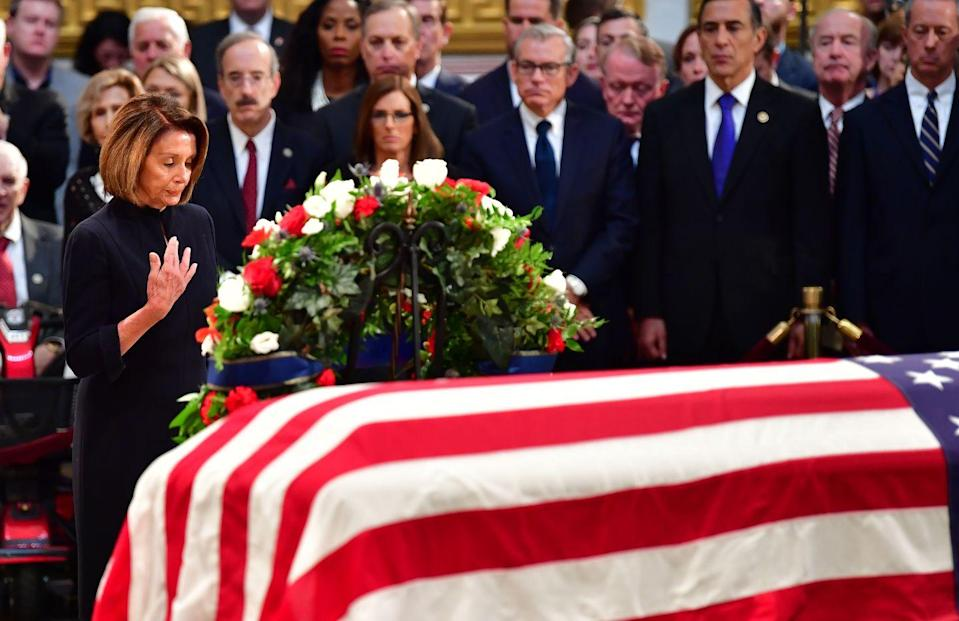 <p>Pelosi mourns the loss of Senator John McCain as he lies in state in Washington D.C. in 2018.</p>
