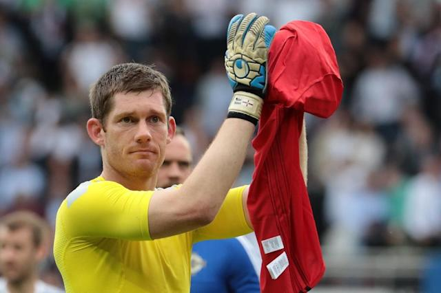 Northern Ireland's goalkeeper Michael McGovern reacts after the Euro 2016 group C football match between Northern Ireland and Germany at the Parc des Princes stadium in Paris on June 21, 2016.Germany won the match 0-1. (AFP Photo/Kenzo Tribouillard)