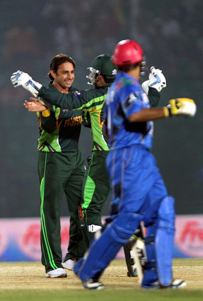 Pakistani bowler Saeed Ajmal celebrates after dismissing Noor Ali Zadran of Afghanistan during the 3rd ODI match of Asia Cup between Pakistan and Afghanistan at Khan Shaheb Osman Ali Stadium in Fatullah of Bangladesh on Feb.27 , 2014. (Photo: IANS)