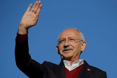 FILE PHOTO: Kemal Kilicdaroglu, the leader of the main opposition Republican People's Party (CHP), greets his supporters during a rally for the upcoming local elections, in Istanbul
