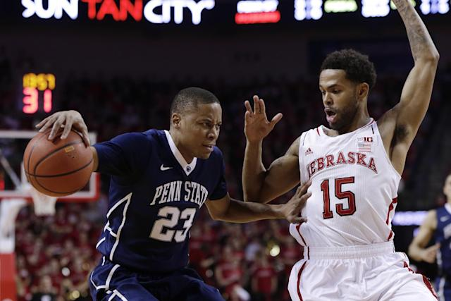 Penn State's Tim Frazier (23) tries to drive around Nebraska's Ray Gallegos (15) in the first half of an NCAA college basketball game in Lincoln, Neb., Thursday, Feb. 20, 2014. (AP Photo/Nati Harnik)