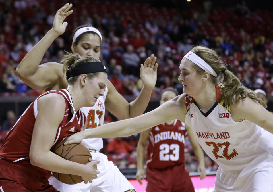 Indiana forward Amanda Cahill, left, tries to protect the ball as she is pressured by Maryland forward Tierney Pfirman, right, and center Brionna Jones in the first half of an NCAA college basketball game, Thursday, Feb. 26, 2015, in College Park, Md. (AP Photo/Patrick Semansky)