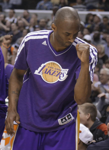 Los Angeles Lakers guard Kobe Bryant celebrates on the bench in the second half of an NBA basketball game against the Indiana Pacers in Indianapolis, Friday, March 15, 2013. The Lakers defeated the Pacers 99-93. Bryant did not play in the second half. (AP Photo/Michael Conroy)