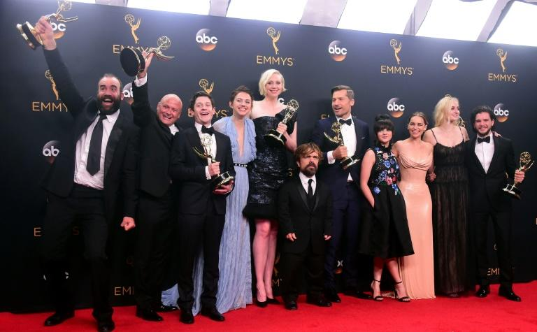 Cast & crew of 'Game of Thrones' pose with the Emmy for  Outstanding Drama Series, in the press room during the 68th Emmy Awards on September 18, 2016 at the Microsoft Theatre in Los Angeles