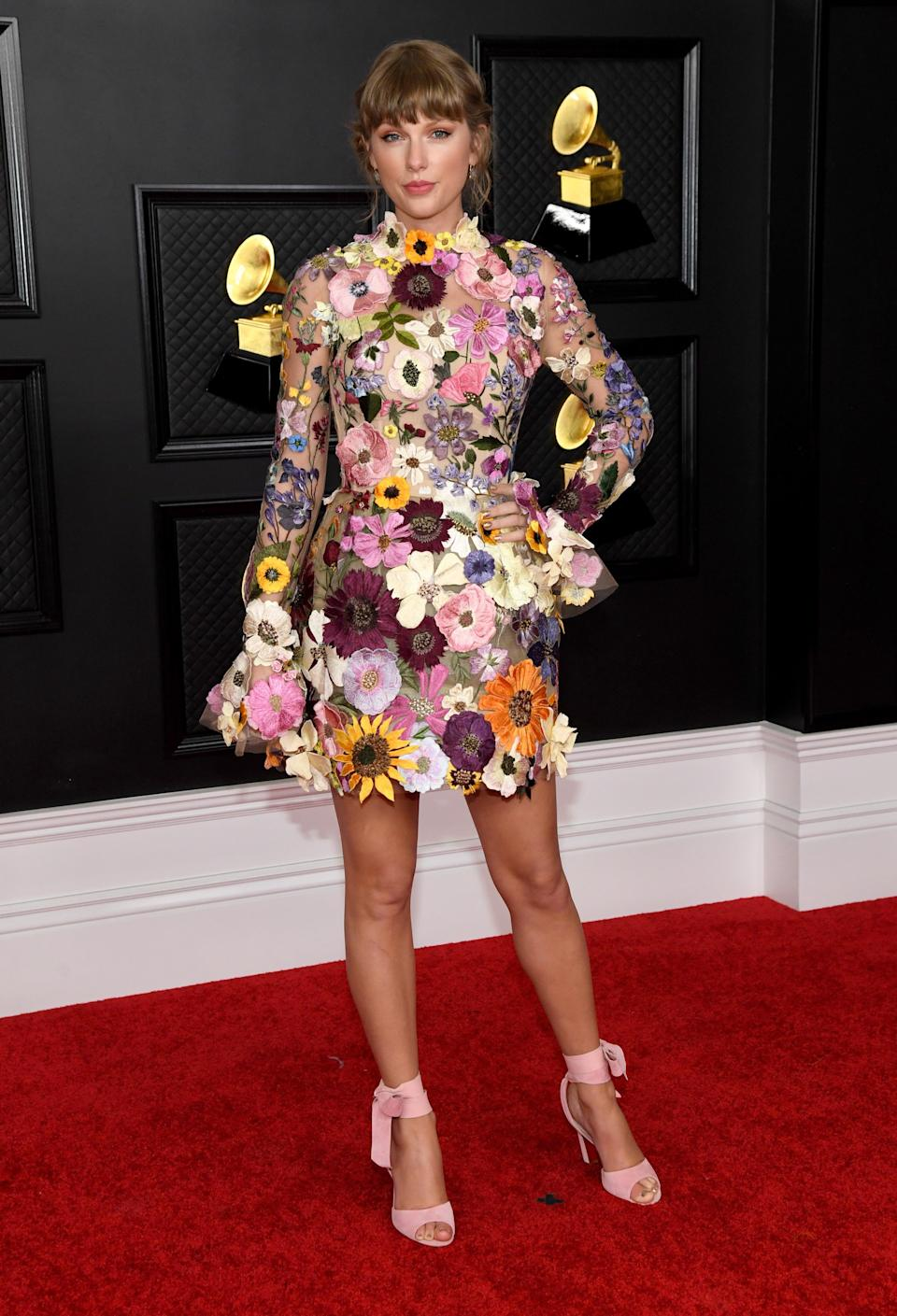 """<h2>Taylor Swift in Oscar de la Renta</h2>Taylor Swift took a break from her <em>folklore</em> prairie dresses and cardigans for the Grammys, choosing, instead, a flower-power mini dress from Oscar de la Renta's fall '21 collection. <br><span class=""""copyright"""">Photo: Kevin Mazur/Getty Images.</span>"""