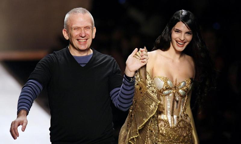 Jean-Paul Gaultier with a catwalk model at his spring/summer 2008 show in Paris.