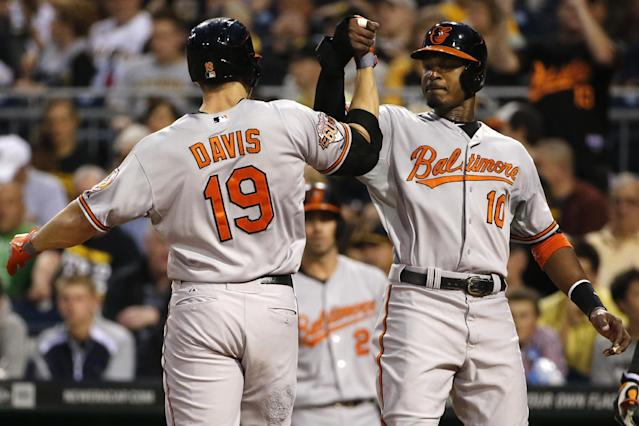 Baltimore Orioles' Chris Davis (19) is greeted by Adam Jones (10) who was on base for Davis' two-run home run off Pittsburgh Pirates starting pitcher Francisco Liriano during the fifth inning of a baseball game in Pittsburgh on Tuesday, May 20, 2014. (AP Photo/Gene J. Puskar)
