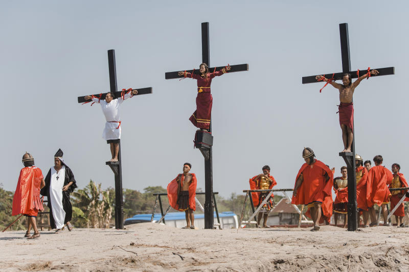 Three Filipino devotees are seen nailed on the cross as part of Good Friday rituals in the village of San Pedro Cutud, Pampanga province, northern Philippines, Friday, April 19, 2019. Over a thousand Filipino Roman Catholic devotees and tourists flocked to a farming village north of Manila on Friday to witness the crucifixion of several devotees in a costumed reenactment of Jesus Christ's sufferings, a gory annual tradition church leaders frown upon. (AP Photo/Iya Forbes)