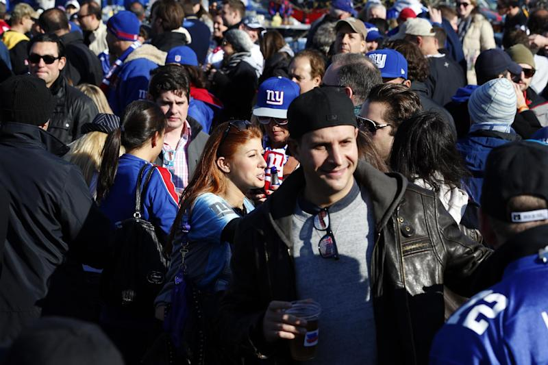 Fans tailgate before an NFL football game between the New York Giants and the Pittsburgh Steelers, Sunday, Nov. 4, 2012, in East Rutherford, N.J. (AP Photo/Julio Cortez)