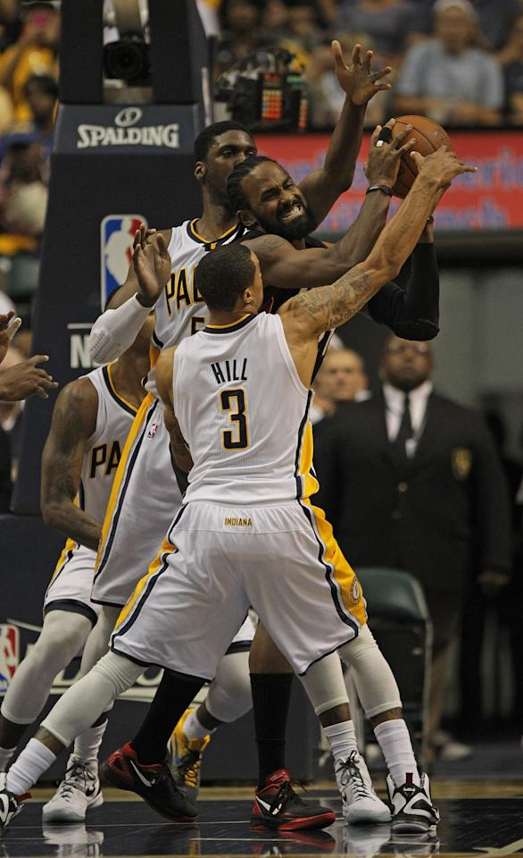 INDIANAPOLIS, IN - MAY 20: George Hill #3 and Roy Hibbert #55 of the Indiana Pacers pressure Ronny Turiaf #21 of the Miami Heat in Game Four of the Eastern Conference Semifinals in the 2012 NBA Playoffs at Bankers Life Fieldhouse on May 20, 2012 in Indianapolis, Indiana. NOTE TO USER: User expressly acknowledges and agrees that, by downloading and/or using this photograph, User is consenting to the terms and conditions of the Getty Images License Agreement. (Photo by Jonathan Daniel/Getty Images)
