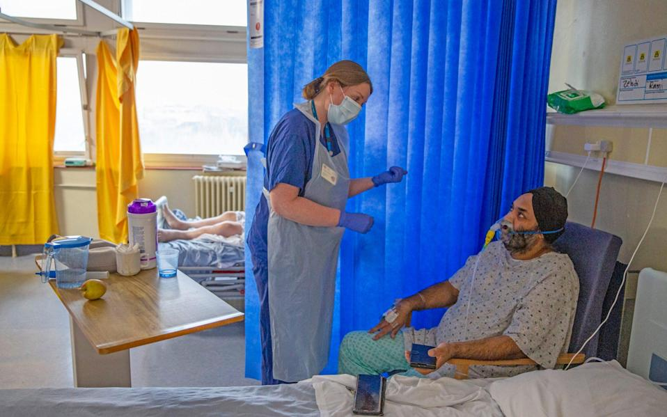 Covid Matron Gill Burnell speaking with patient Jasbir Singh, 51 - Heathcliff O'Malley for the Telegraph