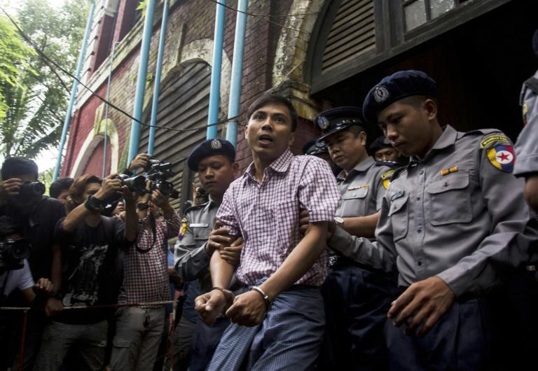 Myanmar journalist Kyaw Soe Oo is escorted out of the court
