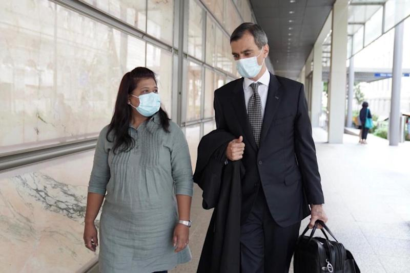 Parti Liyani and her lawyer Anil Balchandani exiting the High Court on 4 September after her acquittal. (PHOTO: Grace Baey)