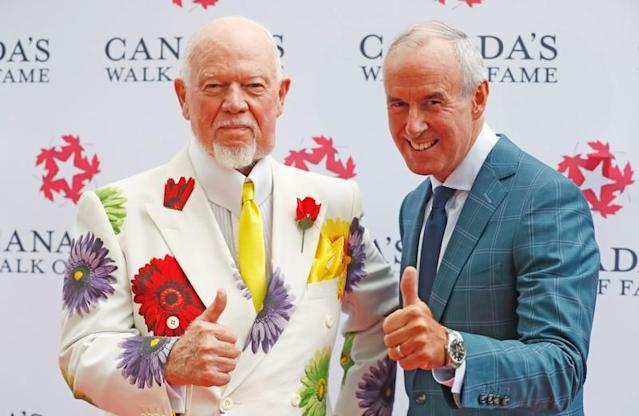 "FILE PHOTO: Storied Canadian hockey sportscasters Don Cherry and Ron MacLean, hosts of ""Coach's Corner on Hockey Night in Canada"", unveil their 2015 Canada's Walk of Fame star on King St in Toronto"