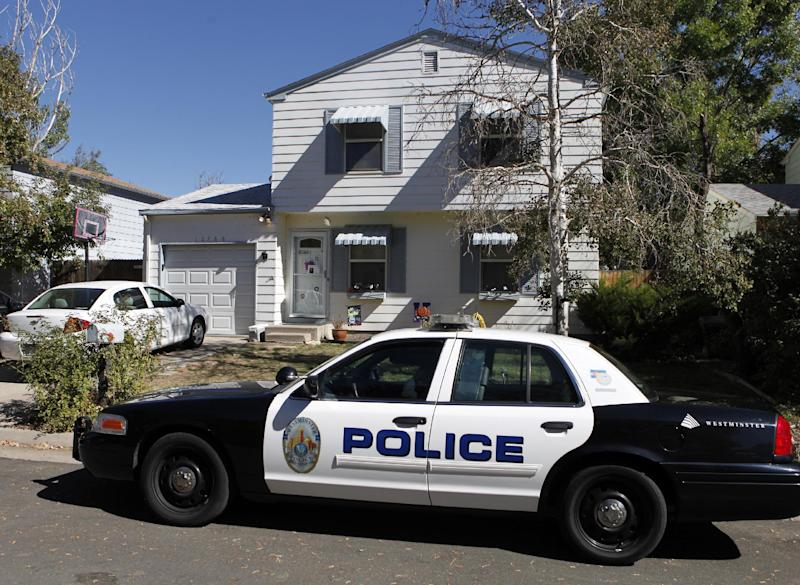 A Westminster police officer sits in her partrol car at the home of ten-year-old Jessica Ridgeway in Westminster, Colo., on Monday, Oct. 8, 2012. The youngster has been missing since she left her home Friday morning on her way to school. (AP Photo/Ed Andrieski)