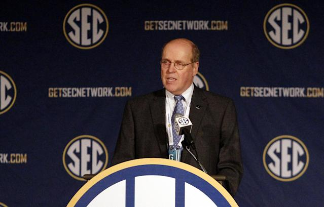 College Football Playoff executive director Bill Hancock speaks to the media at the Southeastern Conference NCAA college football media days, Wednesday, July 16, 2014, in Hoover, Ala. (AP Photo/Butch Dill)