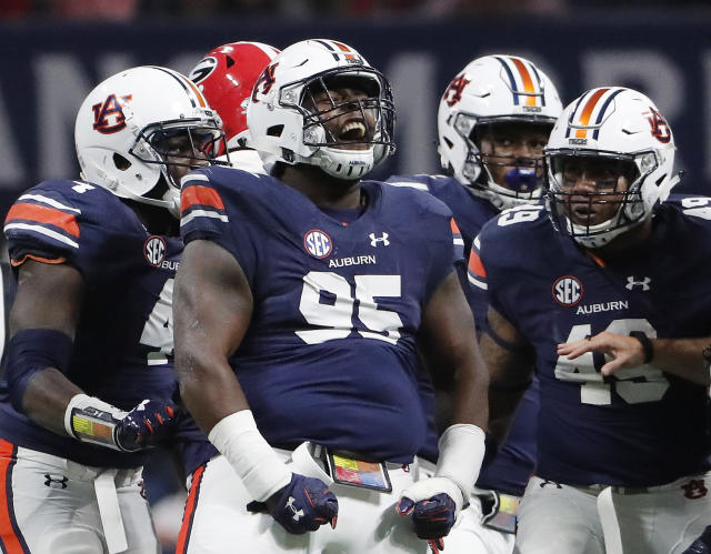 Four-year starter Dontavius Russell (95) is the anchor of Auburn's ferocious front seven. (AP Photo)