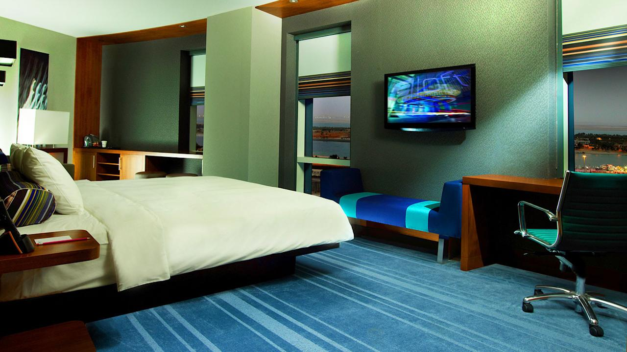 Voice-activated hotel rooms is the latest technology tweak for the Aloft hotel group. A pilot program in a Boston hotel enables control via Siri on an iPad. Occupants can adjust lighting, change the temperature, and even run the TV with Siri.