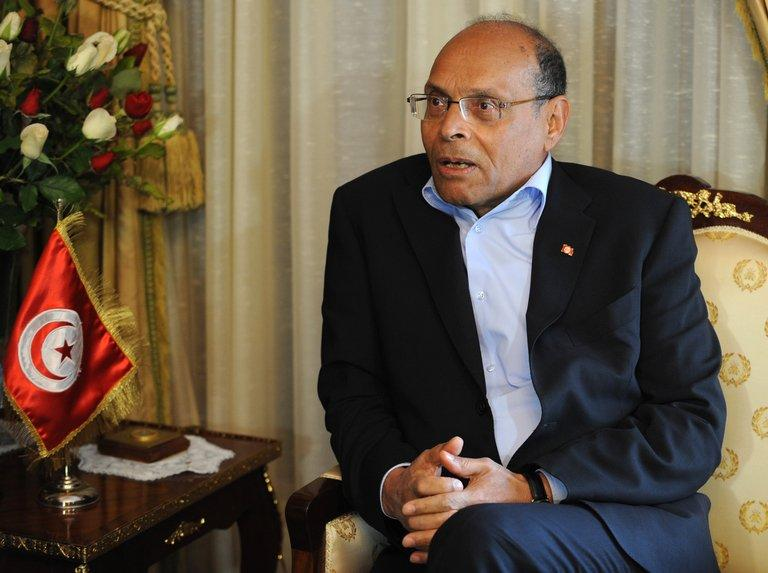Tunisian President Moncef Marzouki meets ruling party leader Rached Ghannouchi (unseen) on February 20, 2013, in Tunis