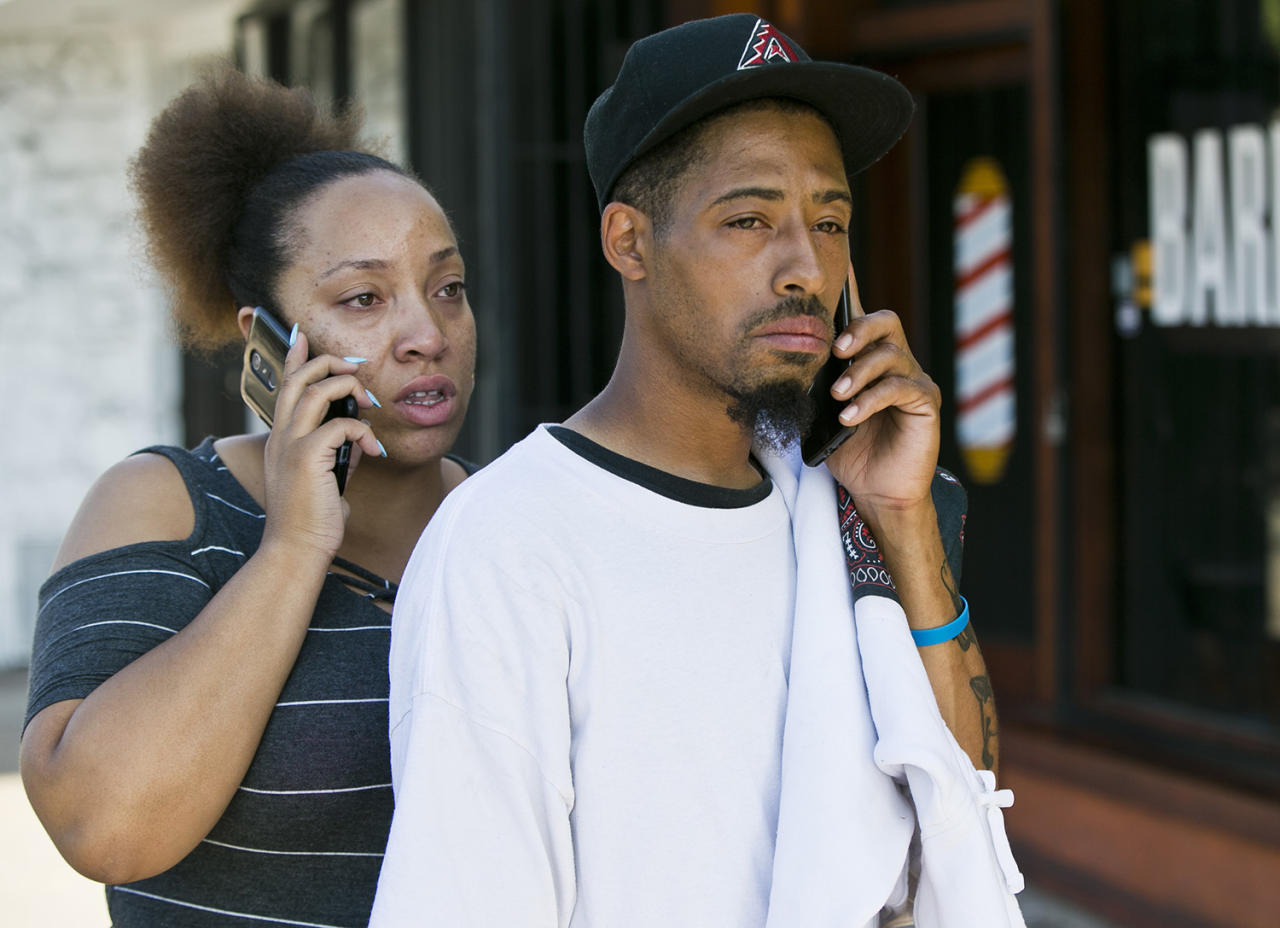 <p>Accident witness Courtney Crump, right, stands with his girlfriend Nicole Gotoy on the scene after Crump witnessed a van that plowed into a group of people dining on a Los Angeles sidewalk inuring several people on Sunday, July 30, 2017. Crumpm told The Associated Press the van jumped a curb and careened into a group of people eating outside The Fish Spot restaurant in the city's Mid-Wilshire neighborhood. The cause of the crash is under investigation. (AP Photo/Damian Dovarganes) </p>