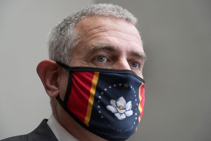 Speaker Philip Gunn, R-Clinton, wearing a new, voter selected Mississippi state flag face mask, speaks with reporters during the first day of the 2021 Mississippi Legislature, Tuesday, Jan. 5, 2021, at the Capitol in Jackson, Miss. (AP Photo/Rogelio V. Solis)