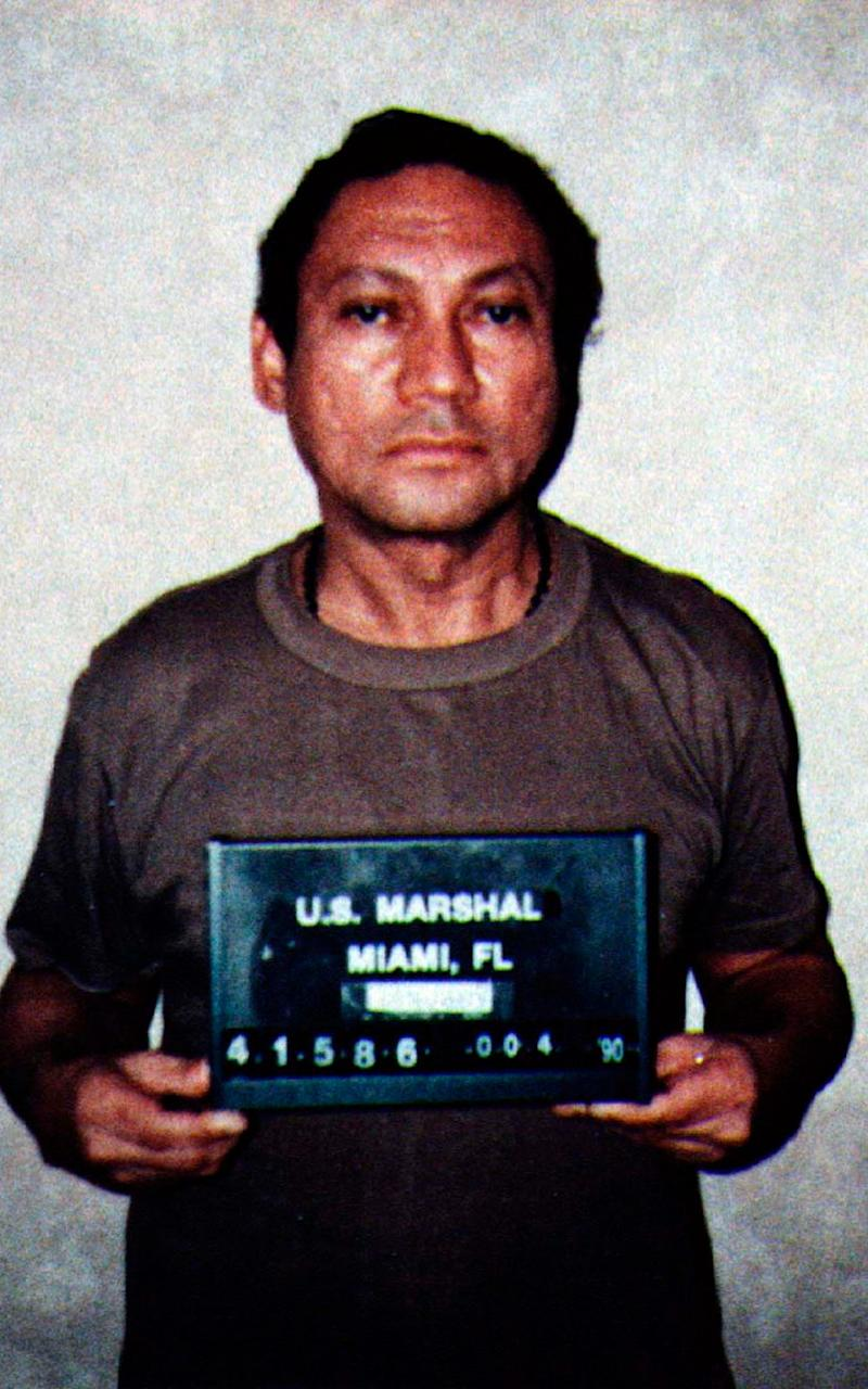 Noriega during his arrest by US Drug Enforcement Agency agents in 1990 - Credit: Reuters