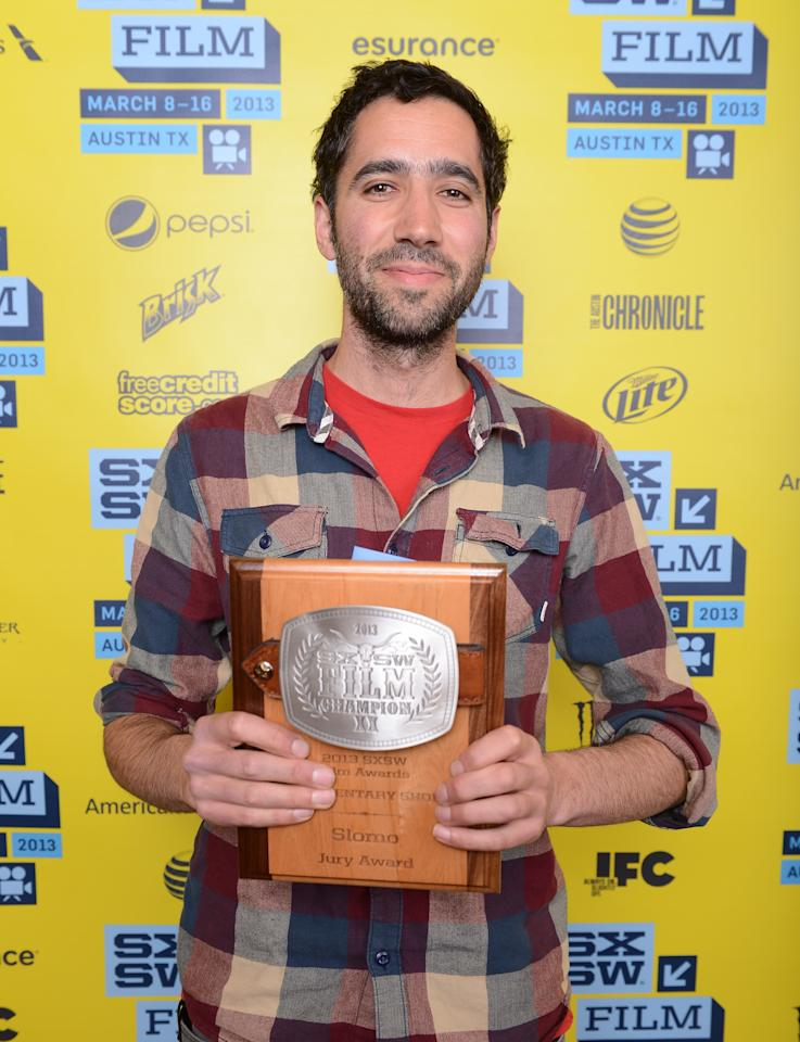 AUSTIN, TX - MARCH 12:  Director Josh Izenberg, winner Short Film Jury Award for Documentary Short poses with his award at the 2013 SXSW Film Awards during the 2013 SXSW Music, Film + Interactive Festival at The Paramount Theatre on March 12, 2013 in Austin, Texas.  (Photo by Michael Buckner/Getty Images for SXSW)