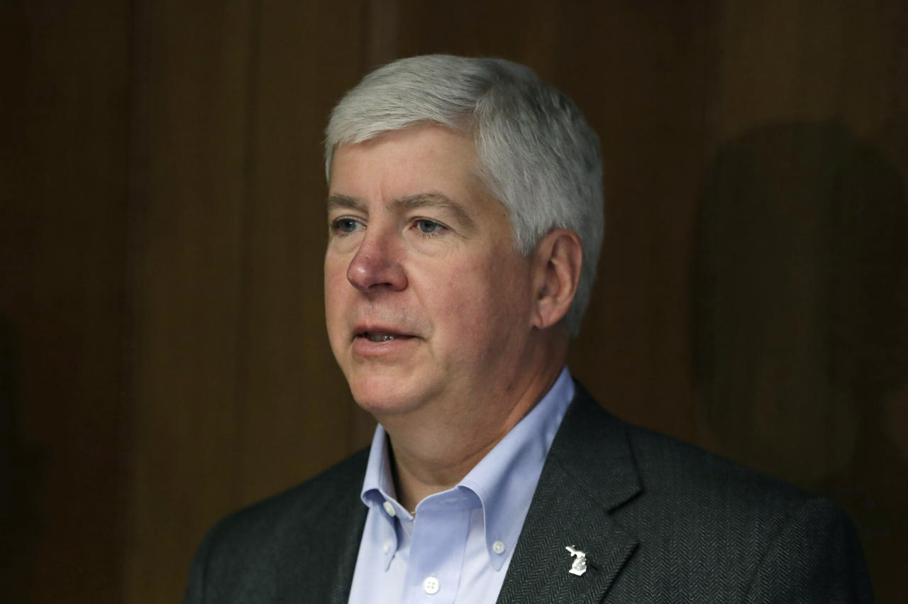 FILE - In this March 13, 2017, file photo, Michigan Gov. Rick Snyder speaks during a news conference in Detroit. The governor on Friday, June 23 urged the Republican-led Michigan House to pass economic development tax incentives when it meets in July, saying there is still time to lure a Taiwanese electronics giant to the state despite the cancellation of a vote on the legislation. Foxconn, which plans to locate a display panel factory in the U.S. that could cost up to $7 billion, will announce investment plans by early August for at least three states, Chairman Terry Gou said Thursday. (AP Photo/Carlos Osorio, File)