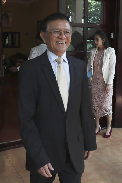 Cambodia National Rescue Party's President Kem Sokha walks to welcome French Ambassador to Cambodia Eva Nguyen Binh who arrives at his house in Phnom Penh, Cambodia, Monday, Nov. 11, 2019. A Cambodian court has lifted some restrictions on detained opposition leader Kem Sokha, essentially ending his house arrest. (AP Photo/Heng Sinith)