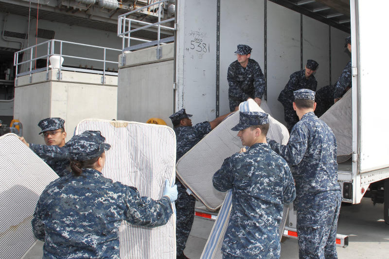 In this Oct. 15, 2012 photo provided by the U.S. Navy, sailors from USS Abraham Lincoln load used mattresses onto a truck to be recycled at Pier 11 Naval Station in Norfolk, Va.  The mattresses from two Virginia-based aircraft carriers and an amphibious transport dock are having their parts recycled by a South Carolina company this year for other uses. In all, the Navy plans to recycle 13,000 mattresses from the USS Enterprise, USS Abraham Lincoln and USS Mesa Verde as part of a pilot program run by Naval Facilities Engineering Command Mid-Atlantic's Integrated Solid Waste. (AP Photo/U.S. Navy, John Land)