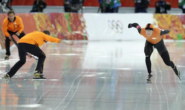 Coach gerard Kemkers urges on Sven Kramer of the Netherlands as he competes in the men's 5,000-meter speedskating race at the Adler Arena Skating Center at the 2014 Winter Olympics in Sochi, Russia, Saturday, Feb. 8, 2014. With the 10,000 meters as good as won four years ago in Vancouver, Kemkers inexplicably pointed Kramer toward the wrong lane on a crossover in the10,000 meters and Kramer, just as inexplicably, followed that road to Olympic ruin. (AP Photo/Matt Dunham)