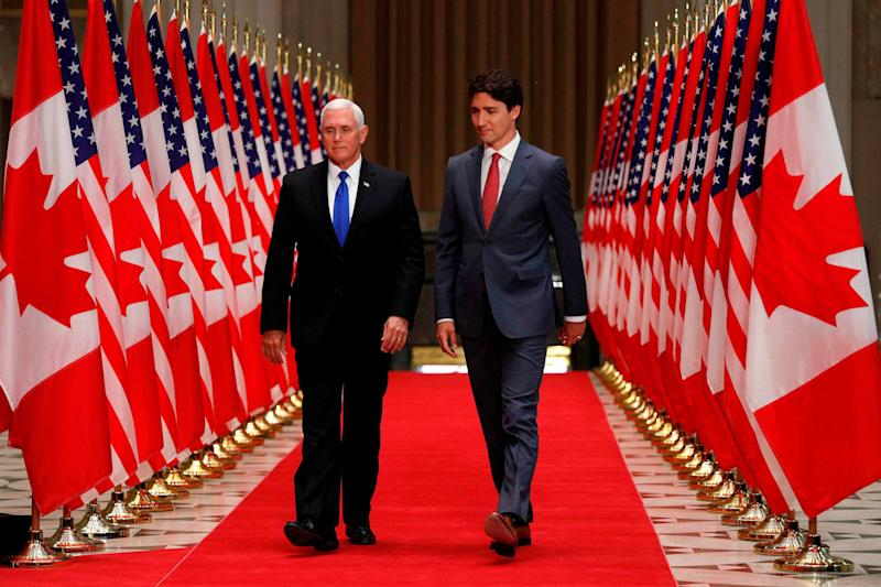 US Vice President Mike Pence (L) and Canadian Prime Minister Justin Trudeau arrive for a joint press conference in Ottawa, Ontario, on May 30, 2019.