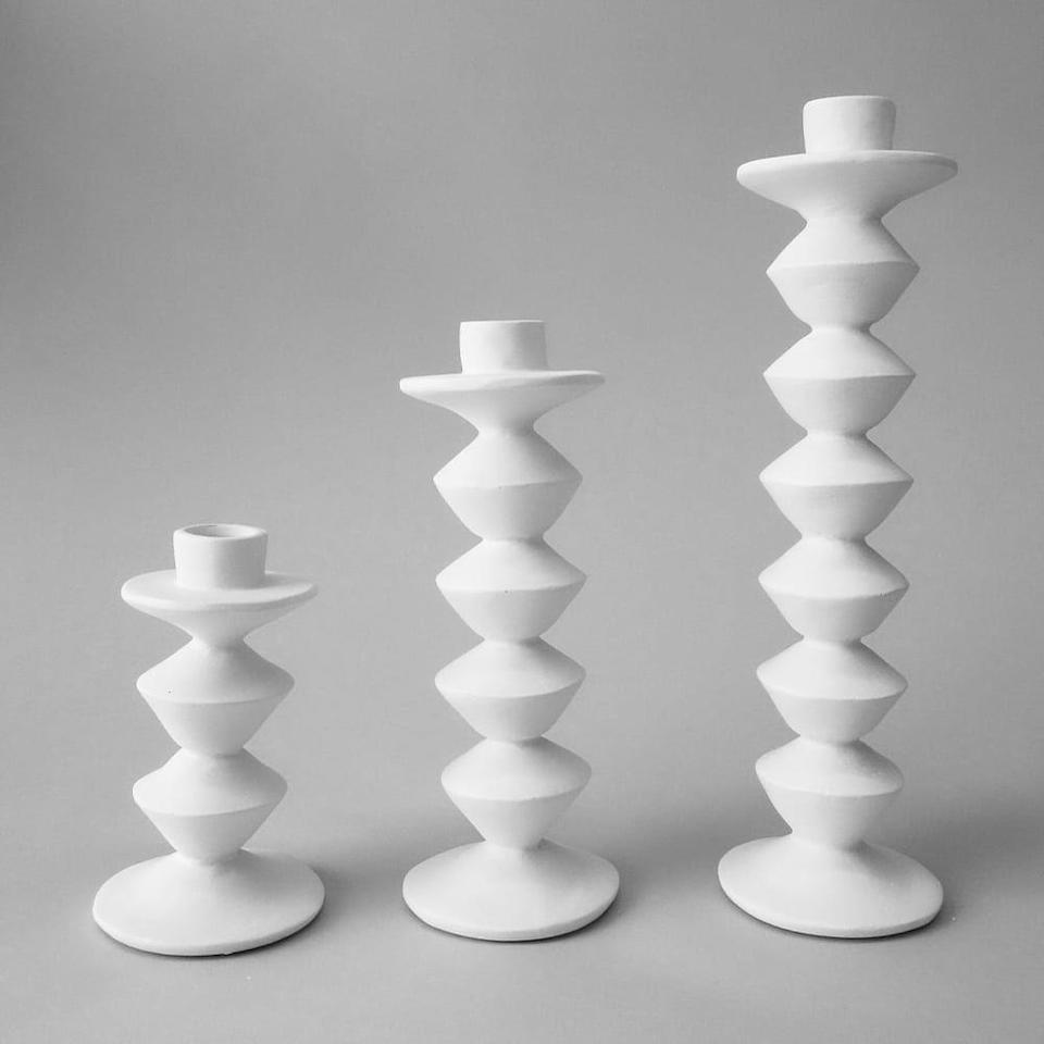 """<p><strong>Stephen Antonson</strong></p><p>theinvisiblecollection.com</p><p><strong>$940.00</strong></p><p><a href=""""https://theinvisiblecollection.com/product/stephen-antonson-zigzag-candlesticks/?attribute_pa_size=large-en&attribute_pa_material=cast-composite"""" rel=""""nofollow noopener"""" target=""""_blank"""" data-ylk=""""slk:Shop Now"""" class=""""link rapid-noclick-resp"""">Shop Now</a></p><p>Lean into the earthenware side of things with these chic candlestick holders. </p>"""