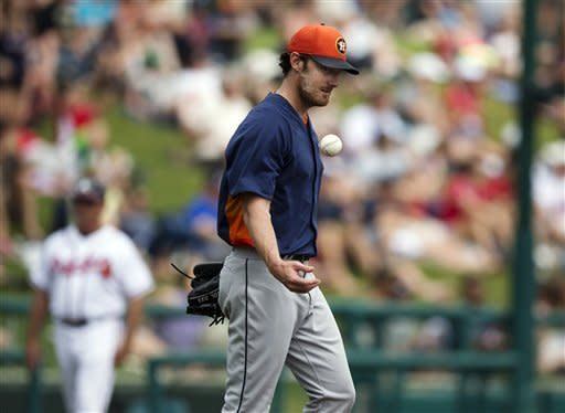 Houston Astros pitcher Philip Humber tosses a new baseball in the air after giving up his third solo home run in the fifth inning an exhibition spring training baseball game against the Atlanta Braves, Saturday, March 23, 2013, in Kissimmee, Fla. (AP Photo/Evan Vucci)