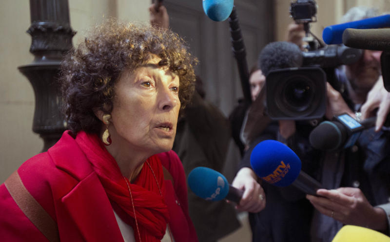 "Francoise Rudetzki, a representative for terrorism victims, answers reporters outside the courtroom where Venezuelan convicted terrorist known as ""Carlos the Jackal"", or Illich Ramirez, is due to appear Monday, May, 13, 2013 in Paris. Carlos the Jackal, the flamboyant terrorist and self-proclaimed revolutionary who was once one of the Cold War's most wanted men, is appealing his life sentence for orchestrating bombings in France two decades ago. Carlos, whose real name is Ilich Ramirez Sanchez, is serving two life sentences in France for a triple murder in 1975 and for the bombings in France in 1982 and 1983 that killed 11 people and injured more than 140. He's been jailed since French agents seized him in Sudan in 1994. (AP Photo/Michel Euler)"