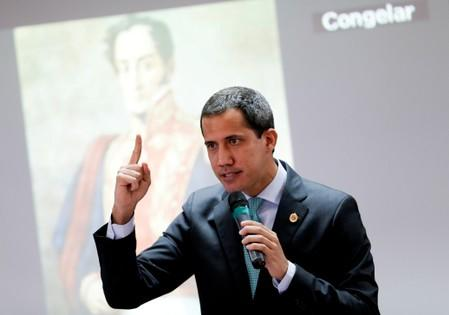 FILE PHOTO: Venezuelan opposition leader Juan Guaido, who many nations have recognized as the country's rightful interim ruler, attends a session of Venezuela's National Assembly in Caracas