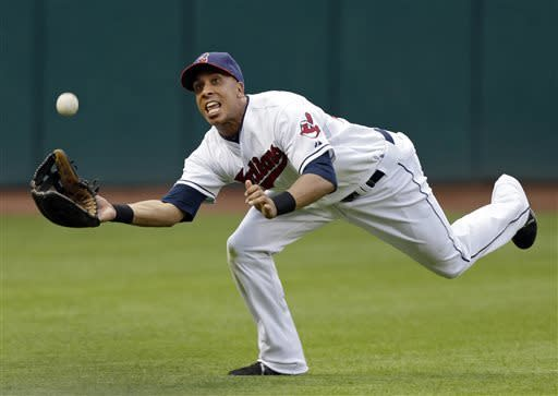 Cleveland Indians left fielder Michael Brantley makes a diving catch on a fly ball by Kansas City Royals' Chris Getz in the sixth inning of a baseball game, Monday, June 17, 2013, in Cleveland. (AP Photo/Mark Duncan)