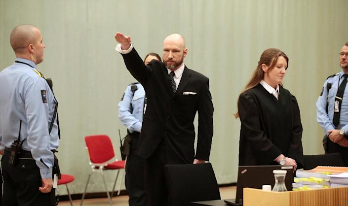 """The extended arm gesture earned Anders Behring Breivik a reprimand from Judge Oystein Hermansen, who described it as """"offensive to the dignity of the court"""" and """"disturbing"""" (AFP Photo/Lise Aaserud)"""