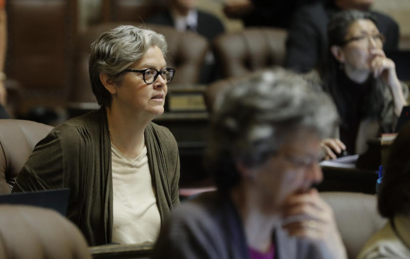 In this April 11, 2019 photo, Rep. Laurie Jinkins, D-Tacoma, listens to debate on the House floor at the Capitol in Olympia, Wash. Jinkins is the sponsor of a measure that has Washington poised to become the first state to establish an employee-paid program creating an insurance benefit to help offset the costs of long-term care, pending a final vote in the House. (AP Photo/Ted S. Warren)