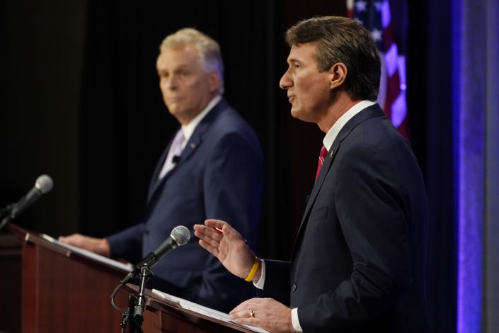 Republican gubernatorial candidate Glenn Youngkin, right, gestures as Democratic gubernatorial candidate former Governor Terry McAuliffe, left, listens during a debate at the Appalachian School of Law in Grundy, Va., Thursday, Sept. 16, 2021. (AP Photo/Steve Helber)