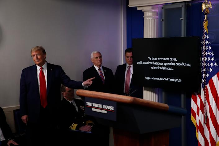 President Donald Trump watches as a White House-produced video plays during a coronavirus news briefing Monday in the James Brady Press Briefing Room at the White House.