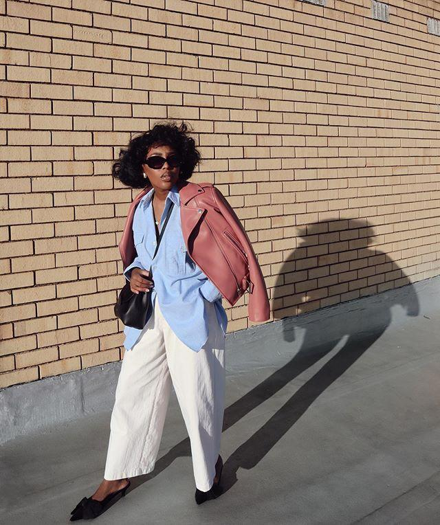 """<p>Summer's ending doesn't mean you have to abandon pretty hues in favor of all-black or head to toe neutrals. Showcase your endless love for pastels with an oversized blue button down layered beneath a salmon-colored leather jacket. </p><p><a href=""""https://www.instagram.com/p/B_r4Rp9J_xt/"""" rel=""""nofollow noopener"""" target=""""_blank"""" data-ylk=""""slk:See the original post on Instagram"""" class=""""link rapid-noclick-resp"""">See the original post on Instagram</a></p>"""