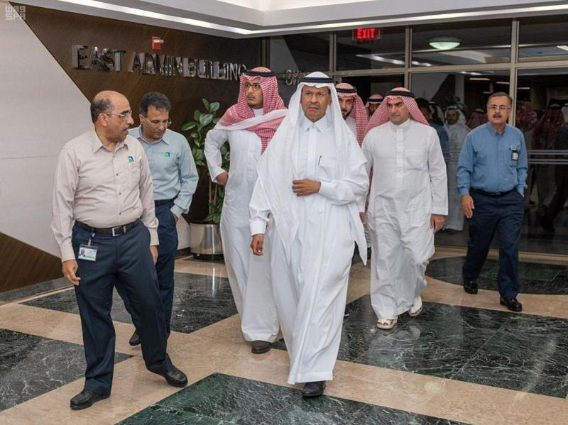 In this Sunday, Sept. 15, 2019, photo released by Saudi Press Agency, SPA, Saudi Energy Minister Prince Abdulaziz bin Salman, center, visits the Saudi Aramco plants one day after the attacks in Abqaiq, Saudi Arabia. (Saudi Press Agency via AP)
