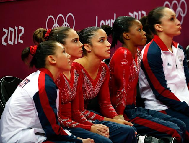 (L-R) Kyla Ross, Mc Kayla Maroney, Alexandra Raisman, Gabrielle Douglas and Jordyn Wieber of the United States watch during the Artistic Gymnastics Women's Team final on Day 4 of the London 2012 Olympic Games at North Greenwich Arena on July 31, 2012 in London, England. (Photo by Jamie Squire/Getty Images)