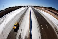 <p>A nearly empty Interstate 30 on Feb. 15 in Fort Worth, Texas. </p>